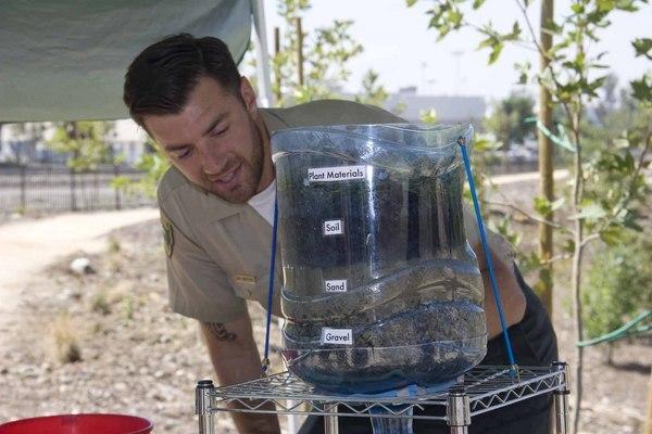 MRCA Naturalist Ian Griffith explains the process of filtration to neighborhood kids | Photo: Carren Jao