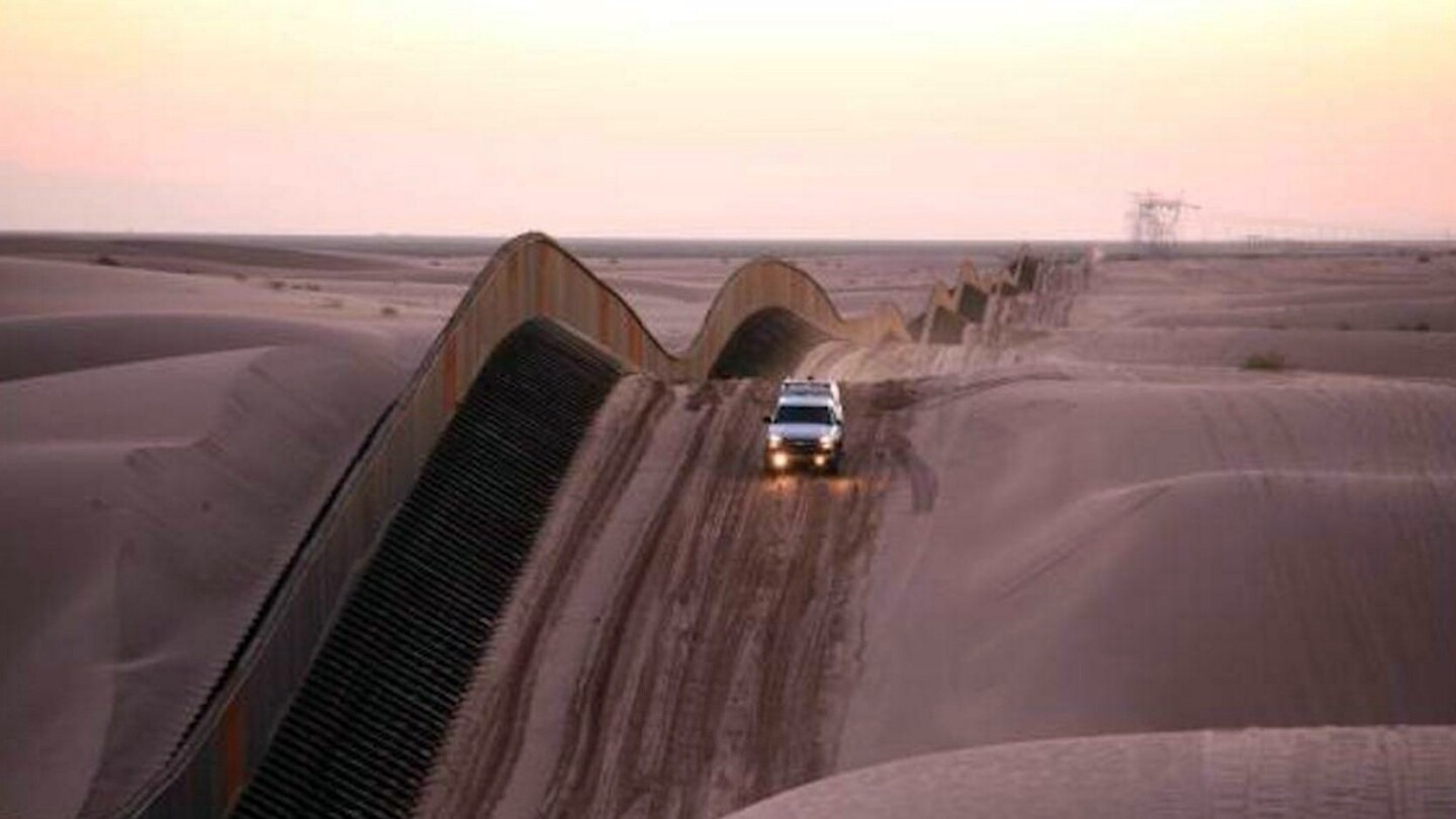 California border along Algodones sand dunes | photo via CALmatters