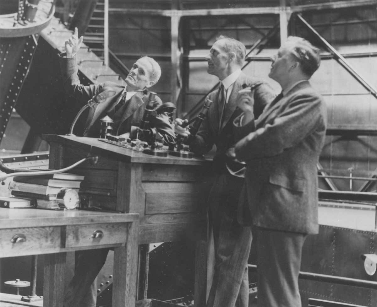 Walter S. Adams, Edwin Powell Hubble and James Hopwood Jeans at the control panel of the Mount Wilson Observatory  |  Image courtesy of the Observatories of the Carnegie Institution for Science Collection at the Huntington Library, San Marino, California
