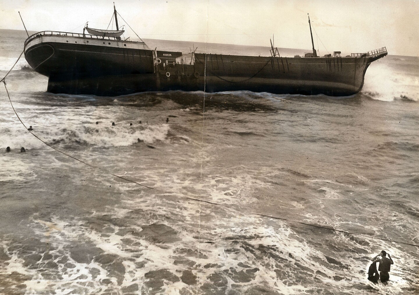 The fishing barge Minne A. Caine, swept ashore near Santa Monica by the 1939 tropical storm. Photo courtesy of the USC Libraries – Los Angeles Examiner Collection.