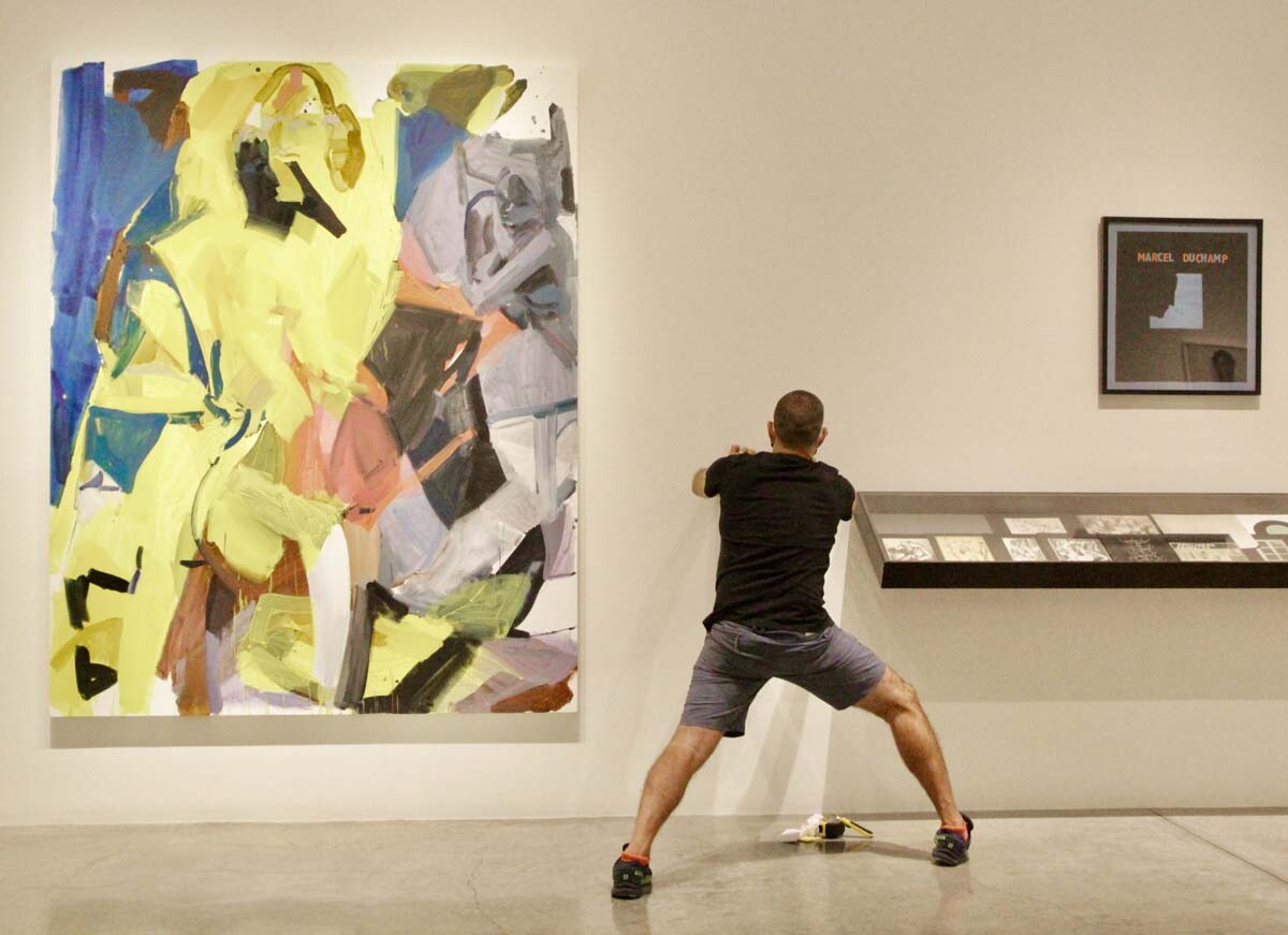 "From left to right, Sarah Awad's ""Pairing 3"", 2020. Oil and vinyl on canvas 90 x 72 in. Marcel Duchamp's signed 1959 ""Self-Portrait in Profile,"" seriograph. Framed Dimensions: 25 1/2 x 23 3/4 in.  