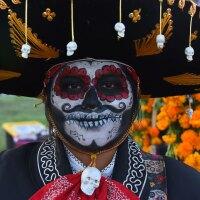 Costumed Calaca Sugar Skull attendees at the Hollywood Forever's Dia De Los Muertos celebration at Hollywood Forever on October 28, 2017 in Hollywood, California. (Photo by Araya Diaz/Getty Images)