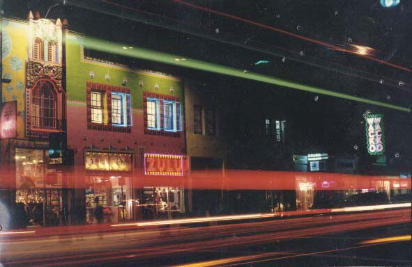 The WACKO/Soap Plant storefront on Melrose Avenue taken at night. Light streaks go across the frame.