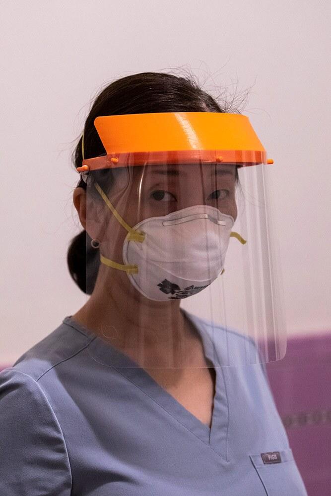 Rieko Takamatsu, art professor Devon Tsuno's wife, wears a face shield made by the 3D PPE Artist Network. | Courtesy of 3D PPE Artist Network