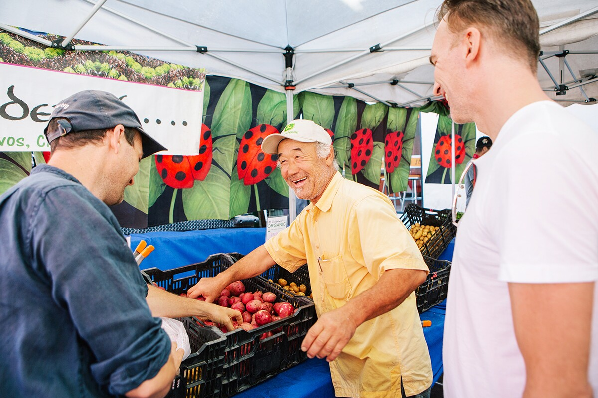 Customers shopping at The Garden Of's stall at the Hollywood Farmers' Market. | Jenny Kim