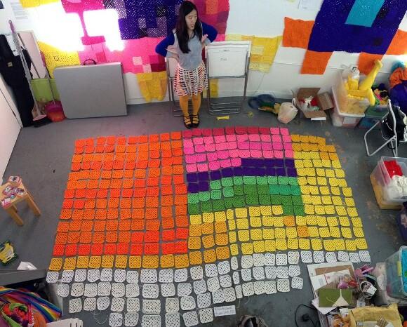 YBLA-er Carol Zou lays out granny squares. | Photo courtesy of YBLA.