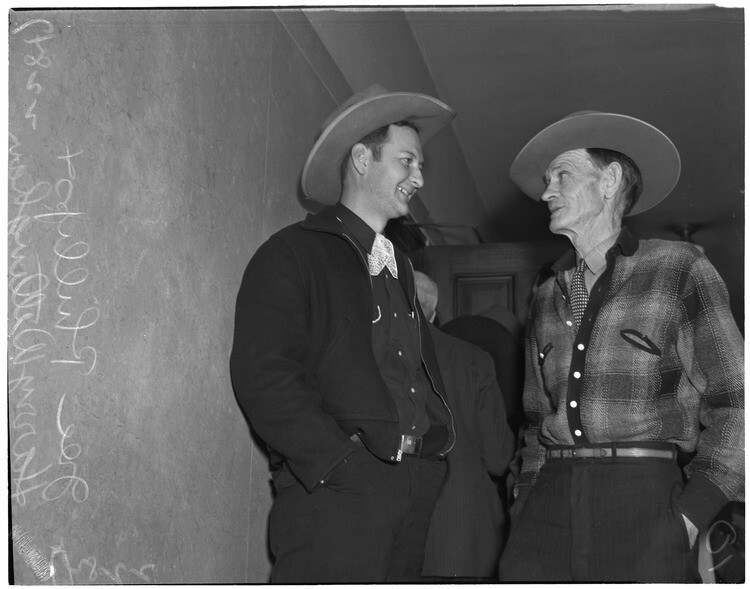 Cowboy film extras Joe Phillips and Harry Willingham at hearing of Jerome (Blackjack) Ward, charged with the murder of Johnny Tyke in Gower Gulch, Los Angeles, February 27, 1940