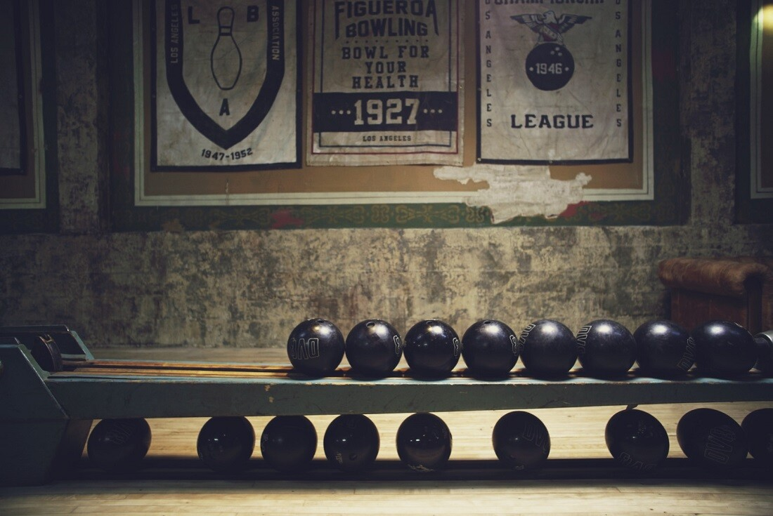 Vintage signage and banners line the walls at the Highland Park Bowl.