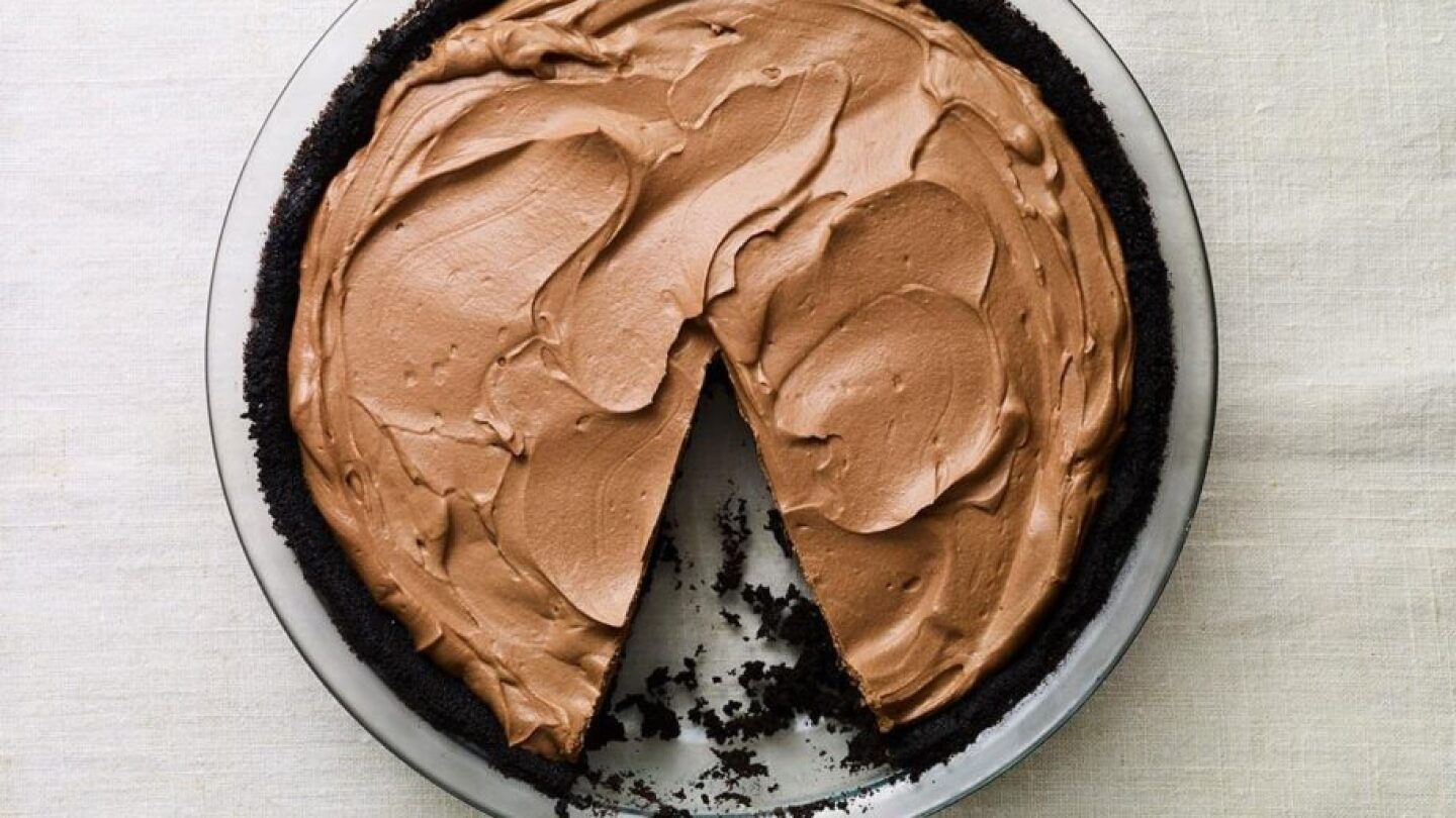 "A No Bake Chocolate Pie with a slice missing. | From ""Pati's Mexican Table: Season 5, Episode 12"""