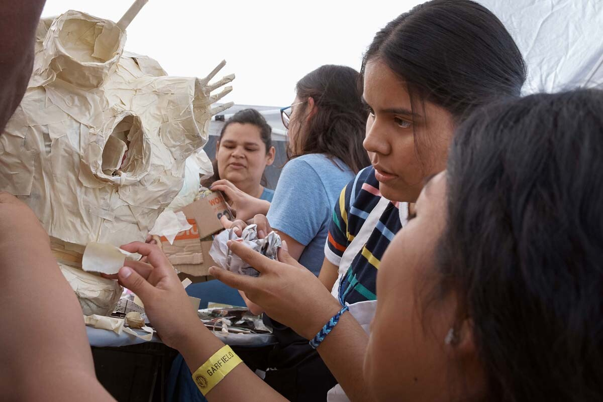 Young girls work on a sculpture at Self Help Graphics' Dia de los Muertos season of workshops, 2019. | Ken Marchionno