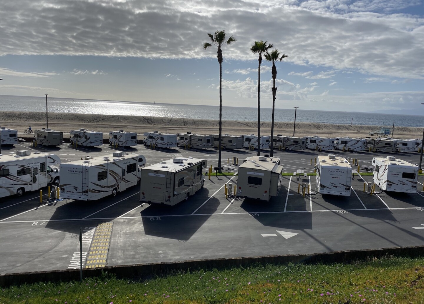 Trainers set up at the Dockweiler beach parking lot for quarantine | Photo taken by Karen Foshay