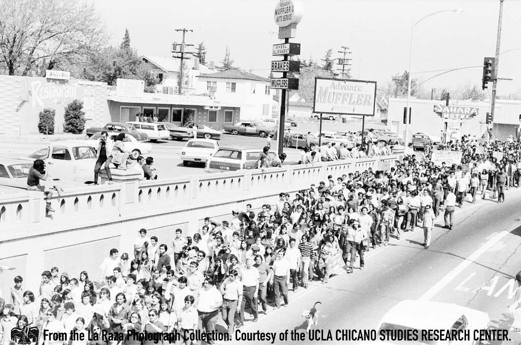 CSRC_LaRaza_B5F3C5_PA_005 People march at Fresno Moratorium | Pedro Arias, La Raza photograph collection. Courtesy of UCLA Chicano Studies Research Center