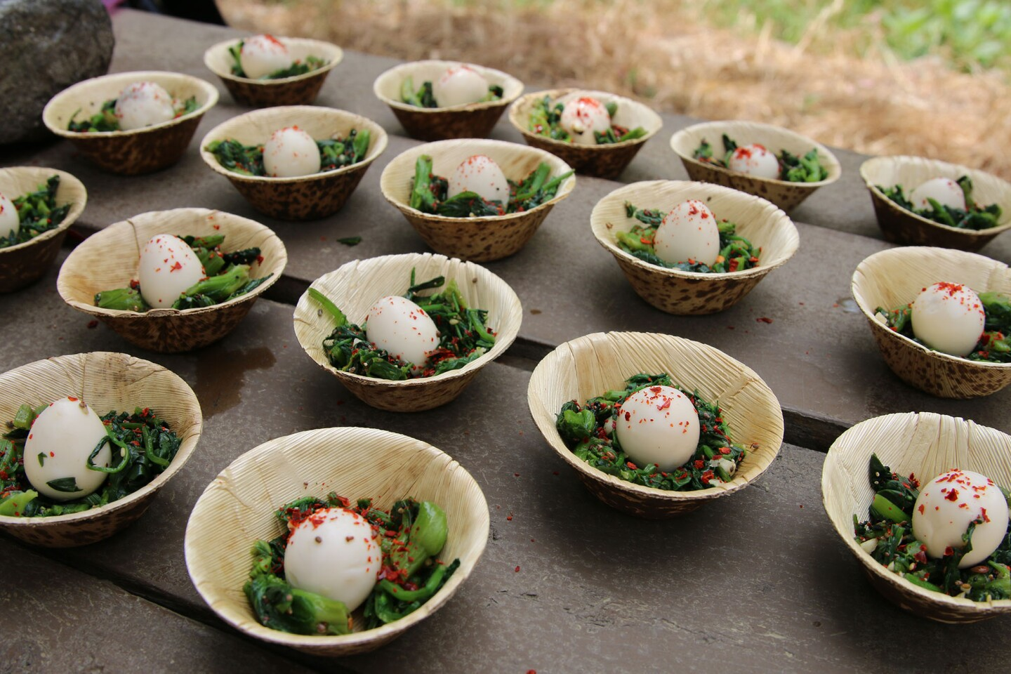 Baudar's quail eggs on top of wild greens I Camille Frazier