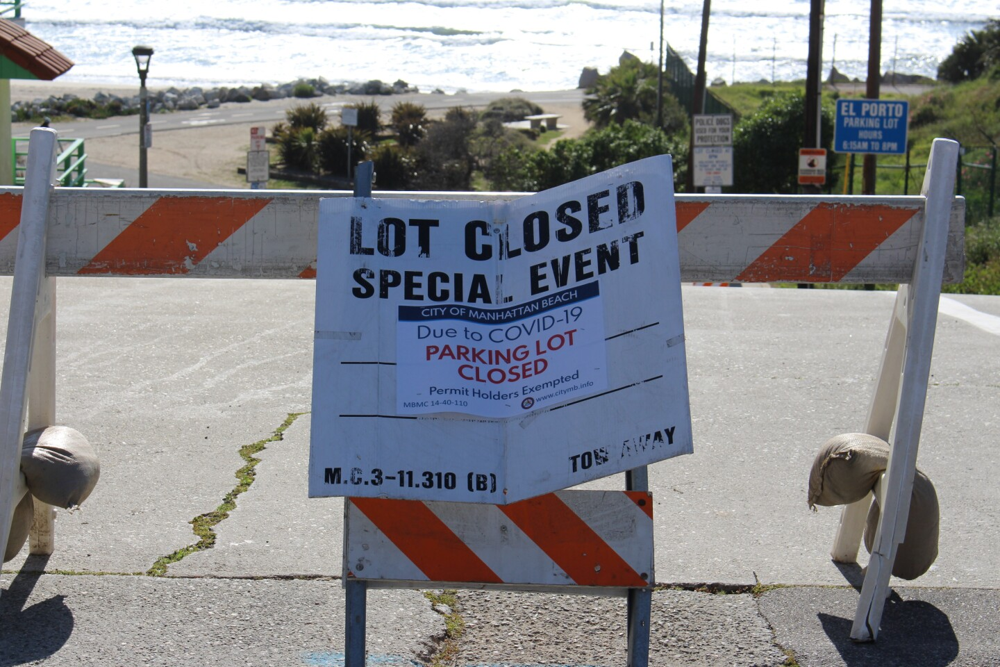 Close up of signage saying beach closed because of COVID19