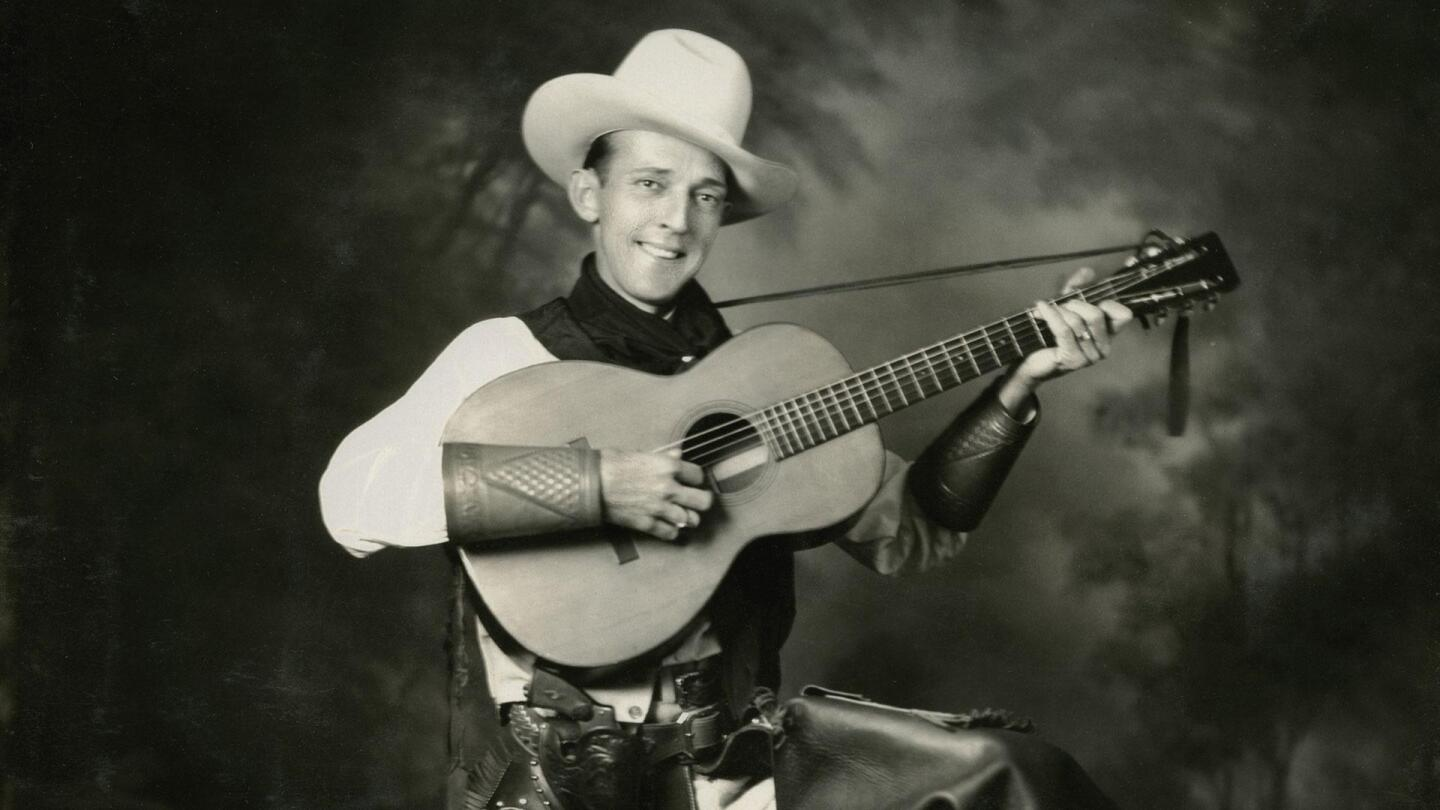 "Jimmie Rodgers holds his guitar. | From ""Country Music: The Rub (Beginnings -1933)"""