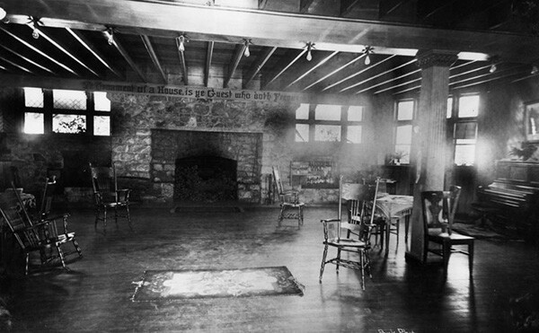 Interior view of Ye Alpine Tavern showing a very large lounge room with a fireplace, chairs and a piano on the right. | Courtesy of the Los Angeles Public Library