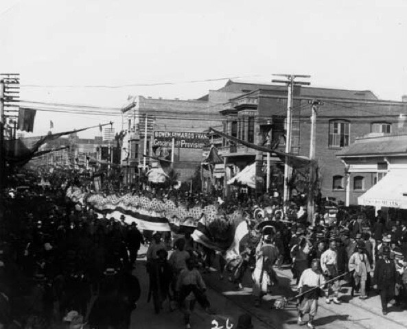 A large crowd gathers to watch the dragon curl through town in the 1890's Fiesta parade.  | Courtesy of the Los Angeles Public Library