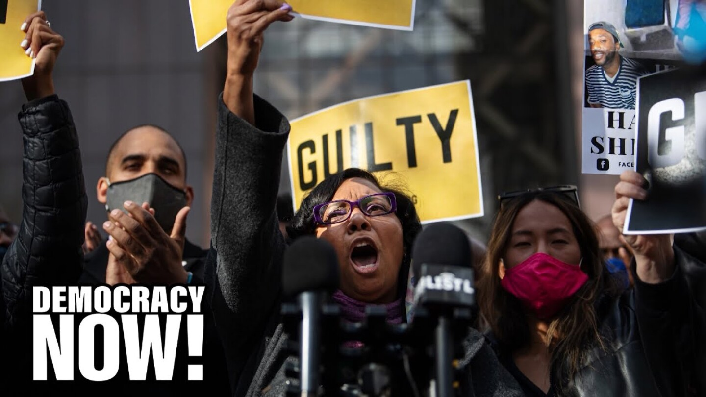 "Demonstrators hold up signs that read ""Guilty."""