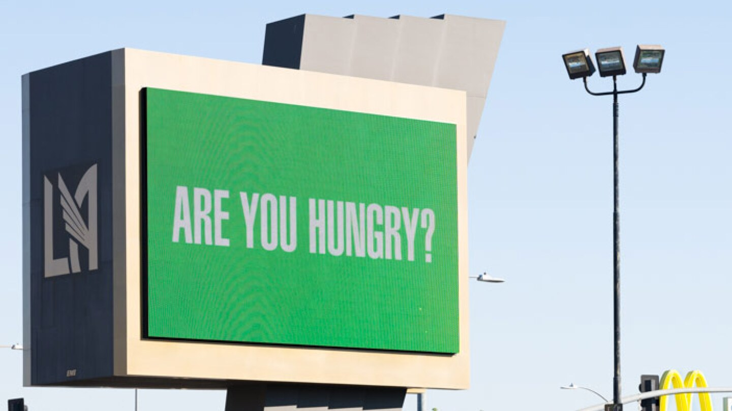 "Barbara Kruger asks ""Are you hungry?"" on a digital billboard at the Banc of California Stadium as part of ""Untitled (Questions)"" 