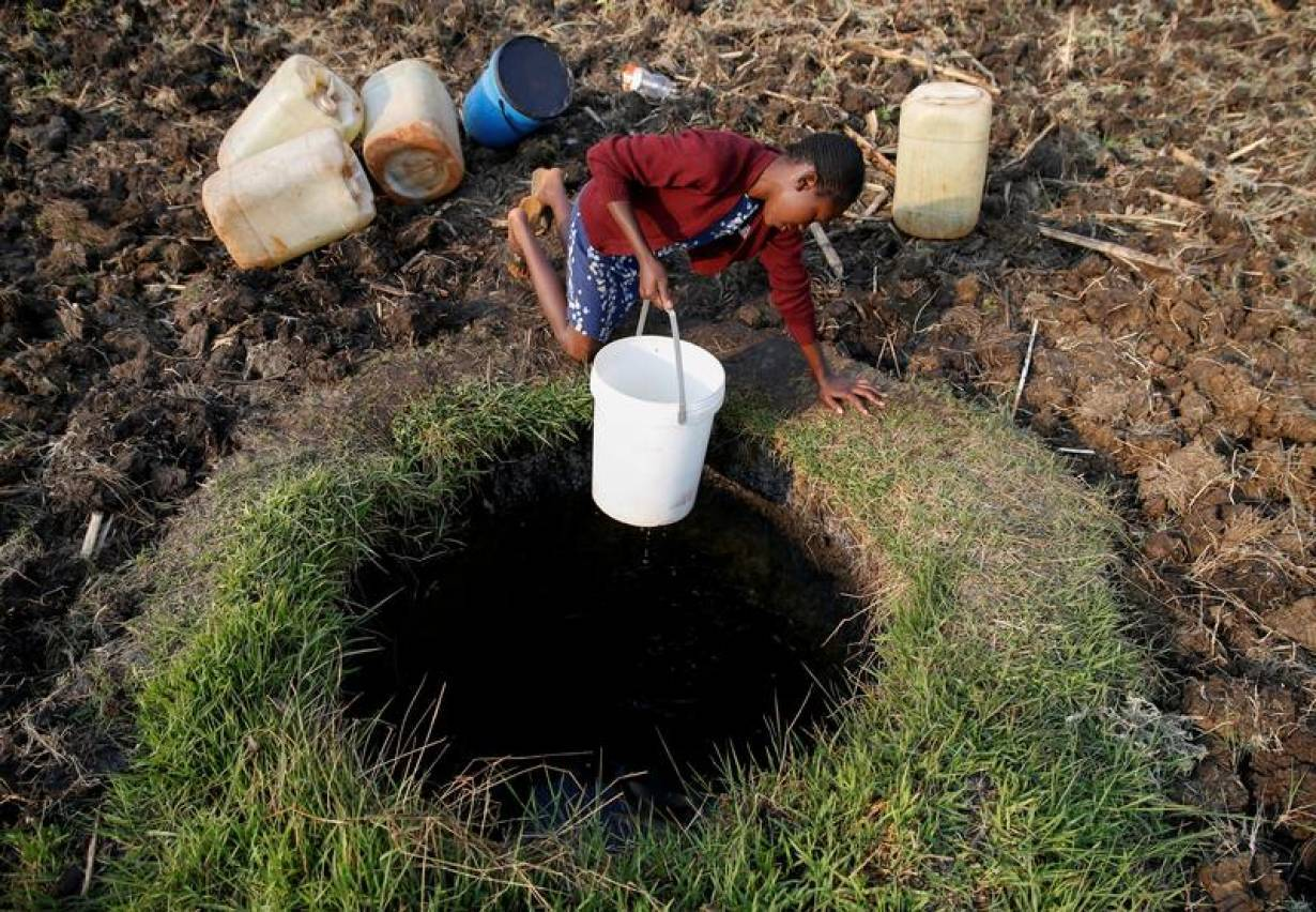 A woman fetches water from a well in Warren Park suburb, Harare, Zimbabwe, September 24, 2019. | REUTERS/Philimon Bulawayo