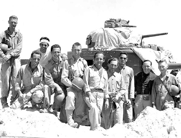 Filmed in and near the Desert Training Center, Sahara not only featured Humphrey Bogart (kneeling at left) but also members of the 4th Armored Division who trained at the DTC. | Courtesy of Eve's Magazine and Kenneth Koyen.