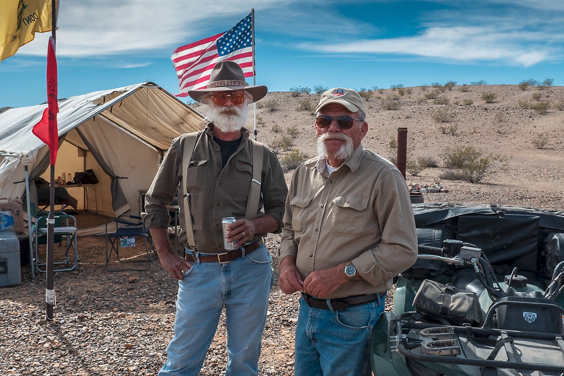 Jim Wharff (right) with Tom Koch (left) who received his 25 FCM membership award in 2019. Wharff occasionally camps in the canvas tent similar to those used during the nineteenth century. | Kim Stringfellow