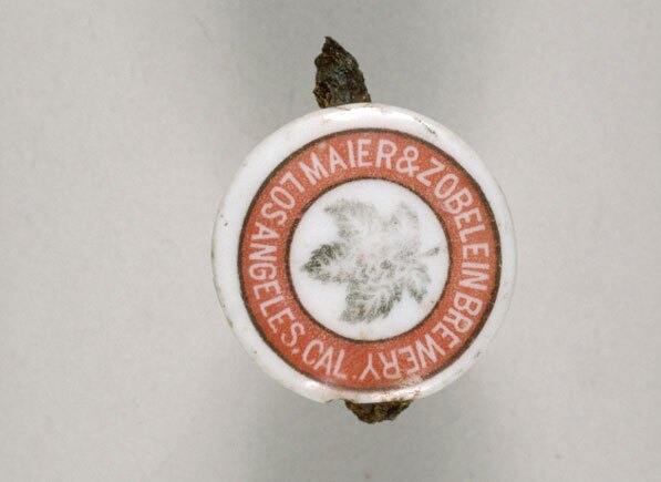 Maier and Zobelein bottle stopper excavated from Union Station, 1989-1991. Courtesy of the Chinese Historical Society of Southern California and USC Digital Library.