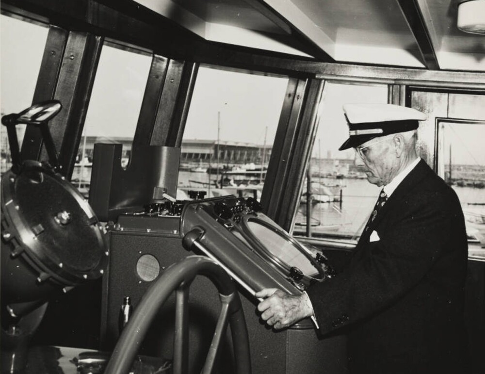 Captain Allan Hancock at gyroscope in pilot house of Velero IV, near Santa Catalina Island, Channel Islands, California, USA, ca. 1949-1950. | Allan Hancock Foundation Collection, USC Libraries