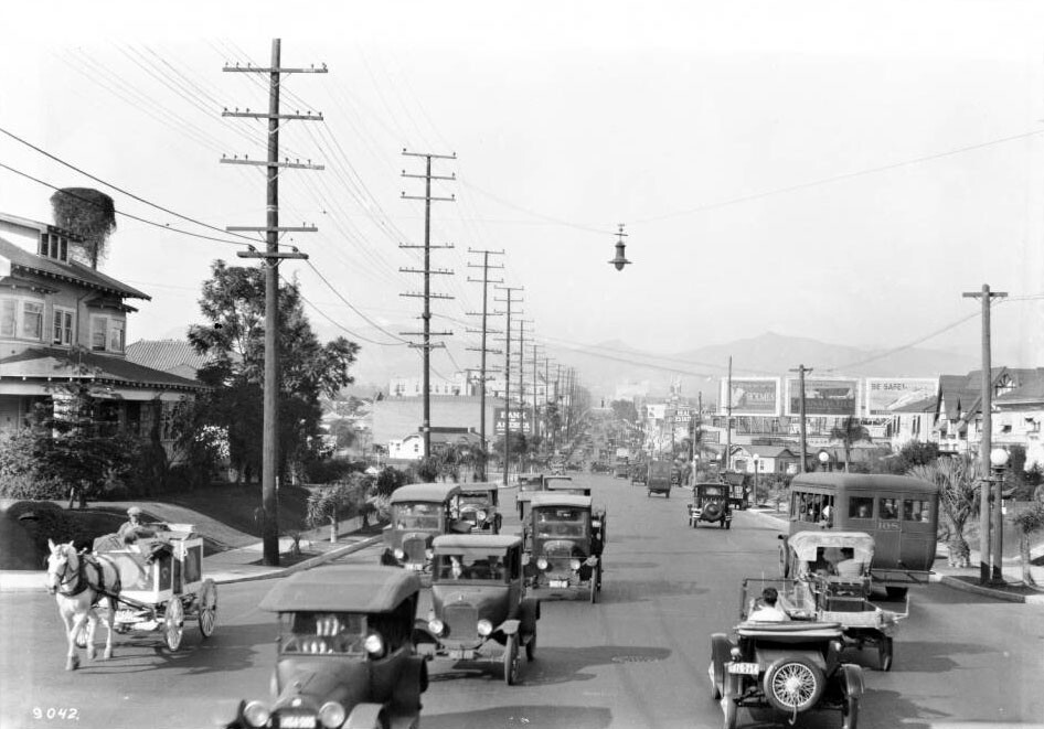 The urban horse survived well into the 1920s, but by the time of this circa 1924 photo horse-drawn vehicles were relegated to the edge of the Los Angeles roadway. Courtesy of the USC Libraries - California Historical Society Collection.