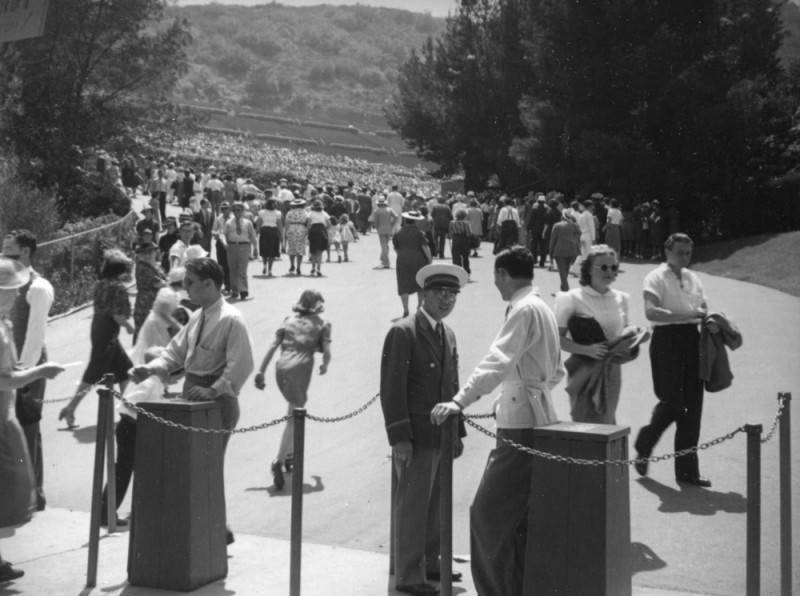 Patrons climbing up the hill to the Hollywood Bowl with their tickets on hand.