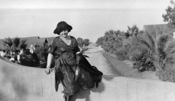 A woman poses on one of the canals' bridges. Courtesy of the Security Pacific National Bank Collection - Los Angeles Public Library.