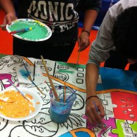 "Children paint as part of the ""Windows To Health"" project"