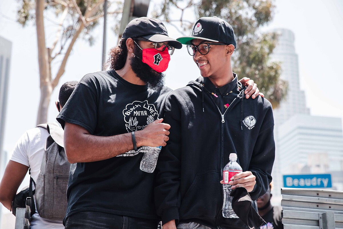 Joseph Williams of  at Students Deserve and Core Leader with Black Lives Matter  talks with Christian Wimberly, youth leader with the Brotherhood Crusade and the Brothers Sons Selves Coalition   Courtesy of Brothers, Sons, Selves