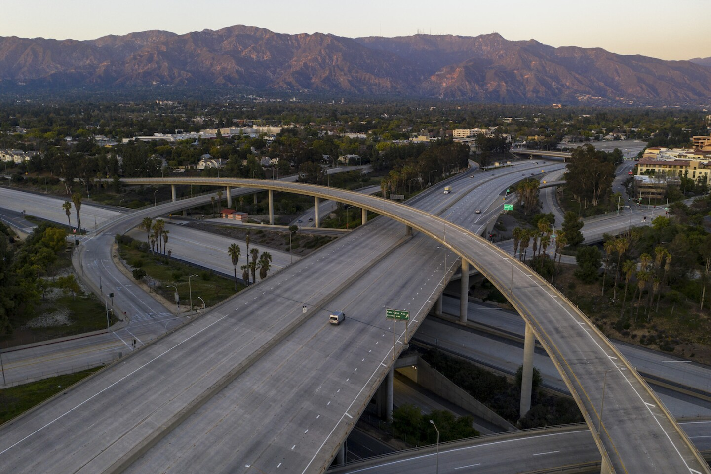 Empty freeways during covid-19 pandemic, with L.A. mountains in the back