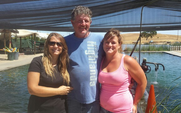 Norm Franklin, center, is the third generation of Franklins to run the family hot springs with his wife, Cindy at left and daughter, Lacey, right.   Photo: Yvonne Willis.