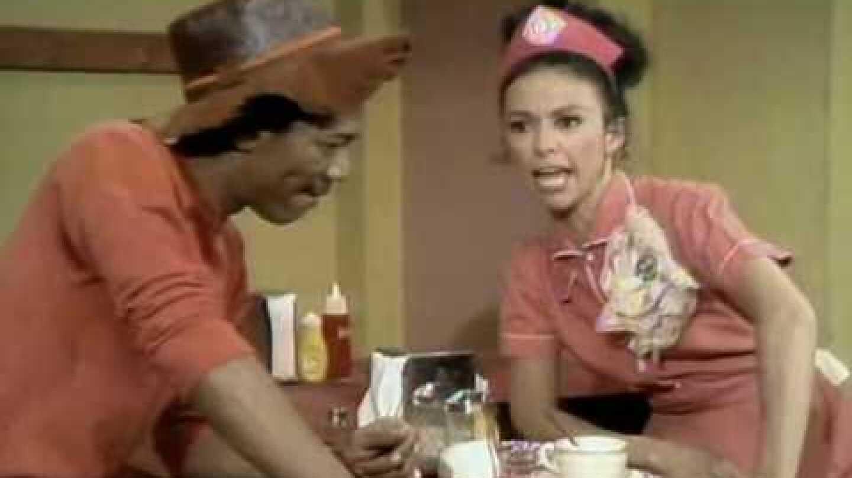 Morgan and Rita sitting at restaurant table