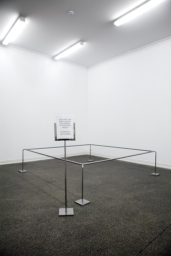 "Dane Mitchell, ""Portal to the Spirit World,"" 2008-1013, spell, stanchions, sign, dimensions variable, lent by the artist, courtesy RaebervonStenglin, Zurich, image courtesy of Otis College of Art.]"