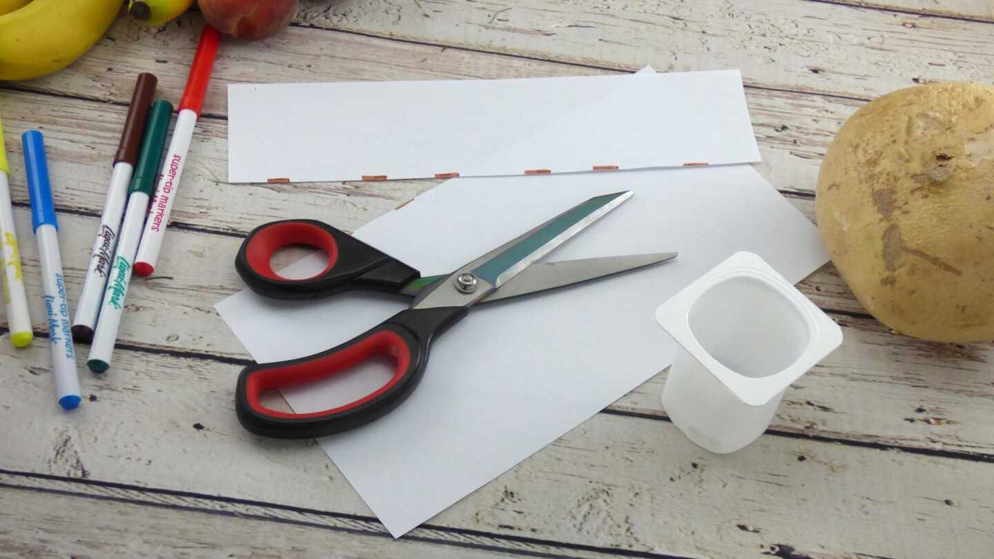 Cut strips of paper for treasure chest.