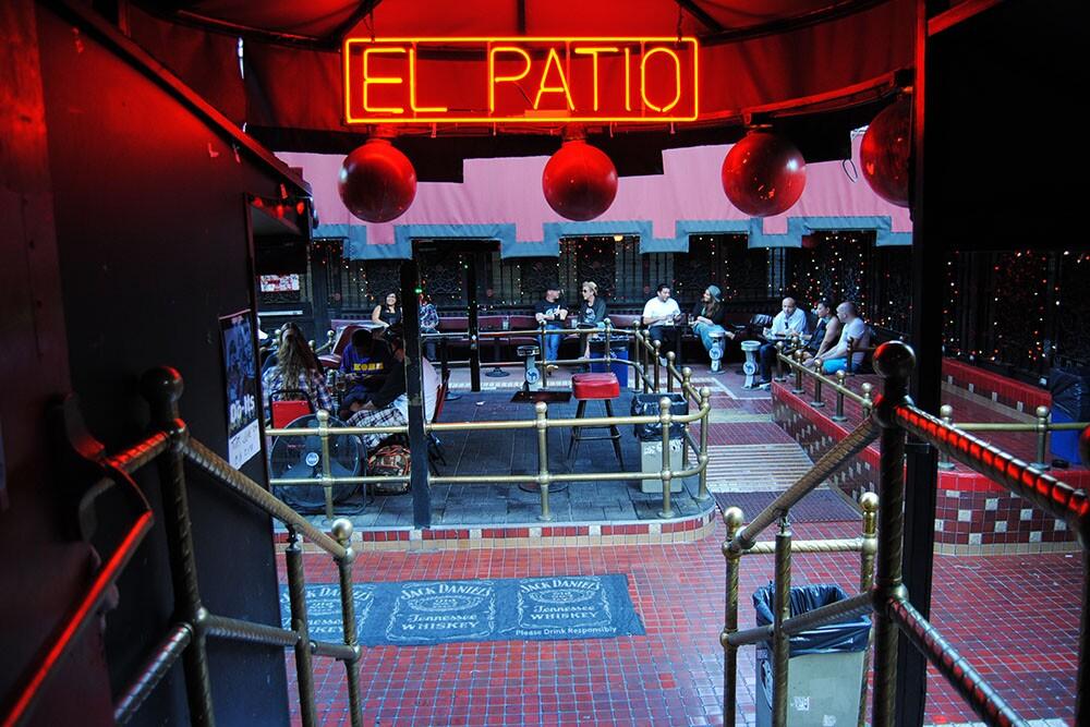 """La Cita's patio, with neon sign reading """"El Patio.""""   Samanta Helou"""
