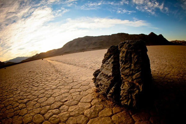 A rock and its trail behind it at Racetrack Playa in Death Valley National Park.