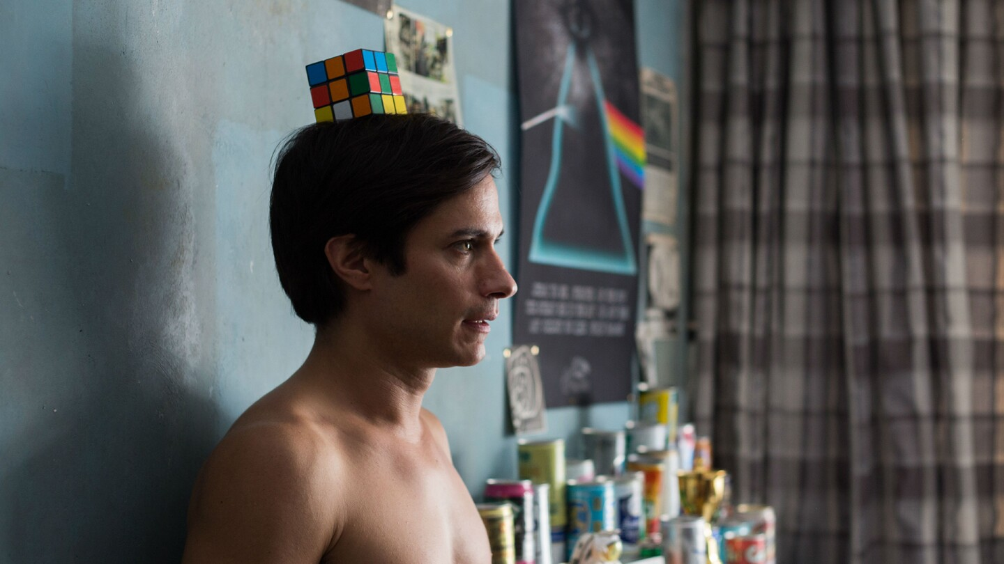 "A man balances a Rubik's Cube on his head. | From ""Museo"""