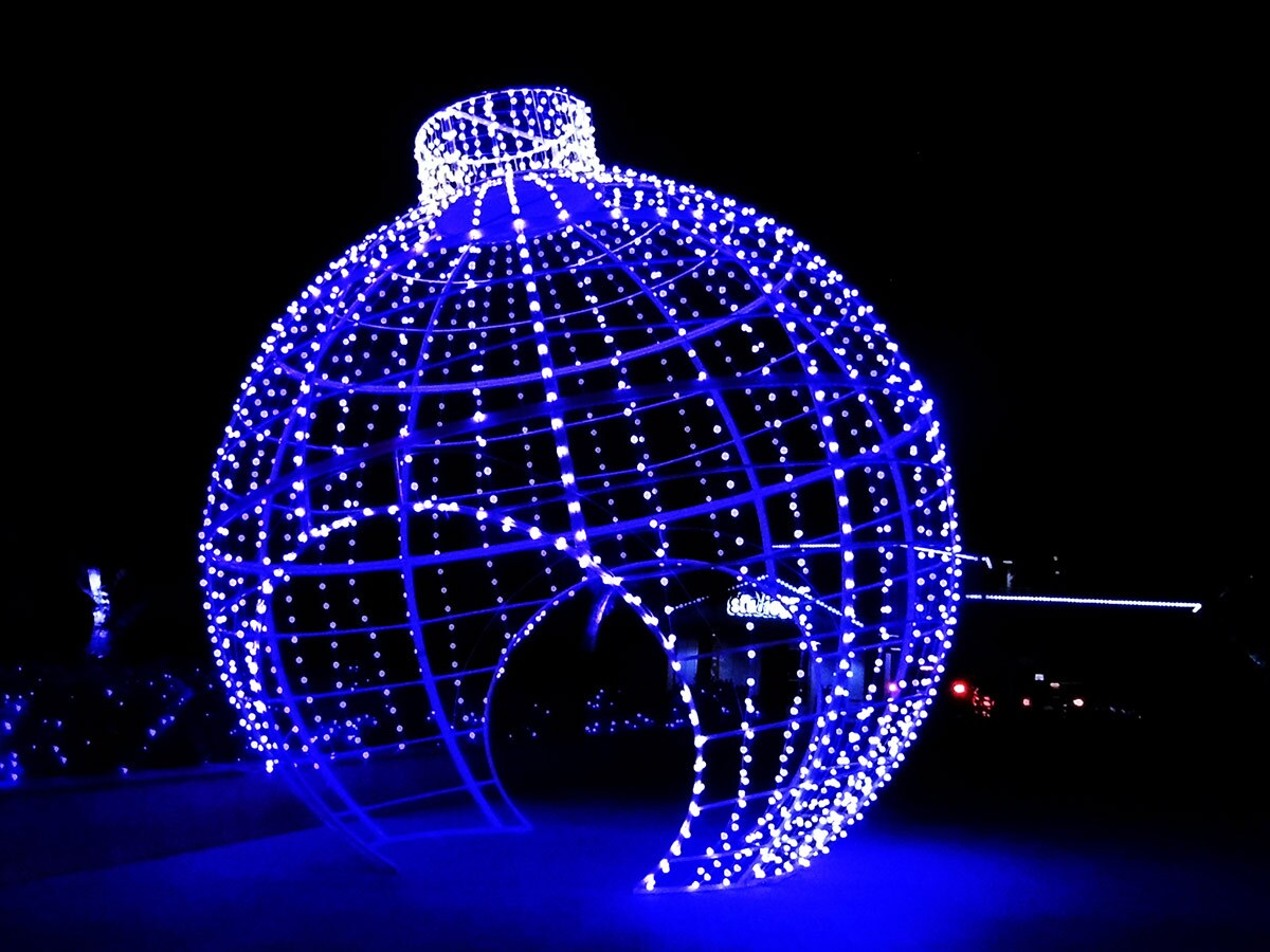 A giant ornament made of blue lights at Holiday in the Park at Six Flags Magic Mountain. | Sandi Hemmerlein