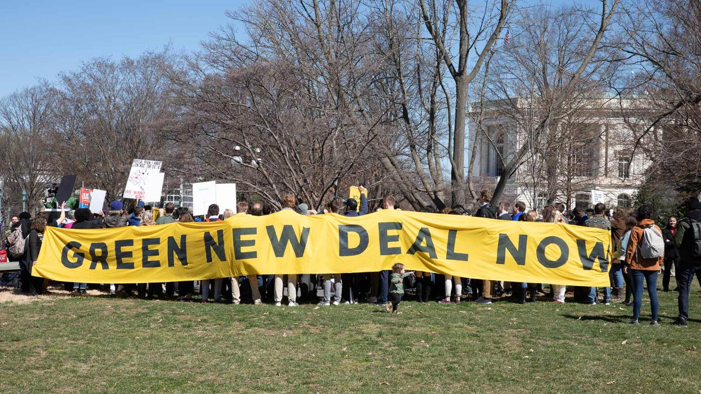 "Activist outside the Congress demanding a vote to pass ""The Green New Deal."" 