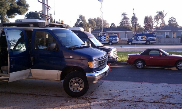 News vans gather at Gardena High School after this week's shooting.