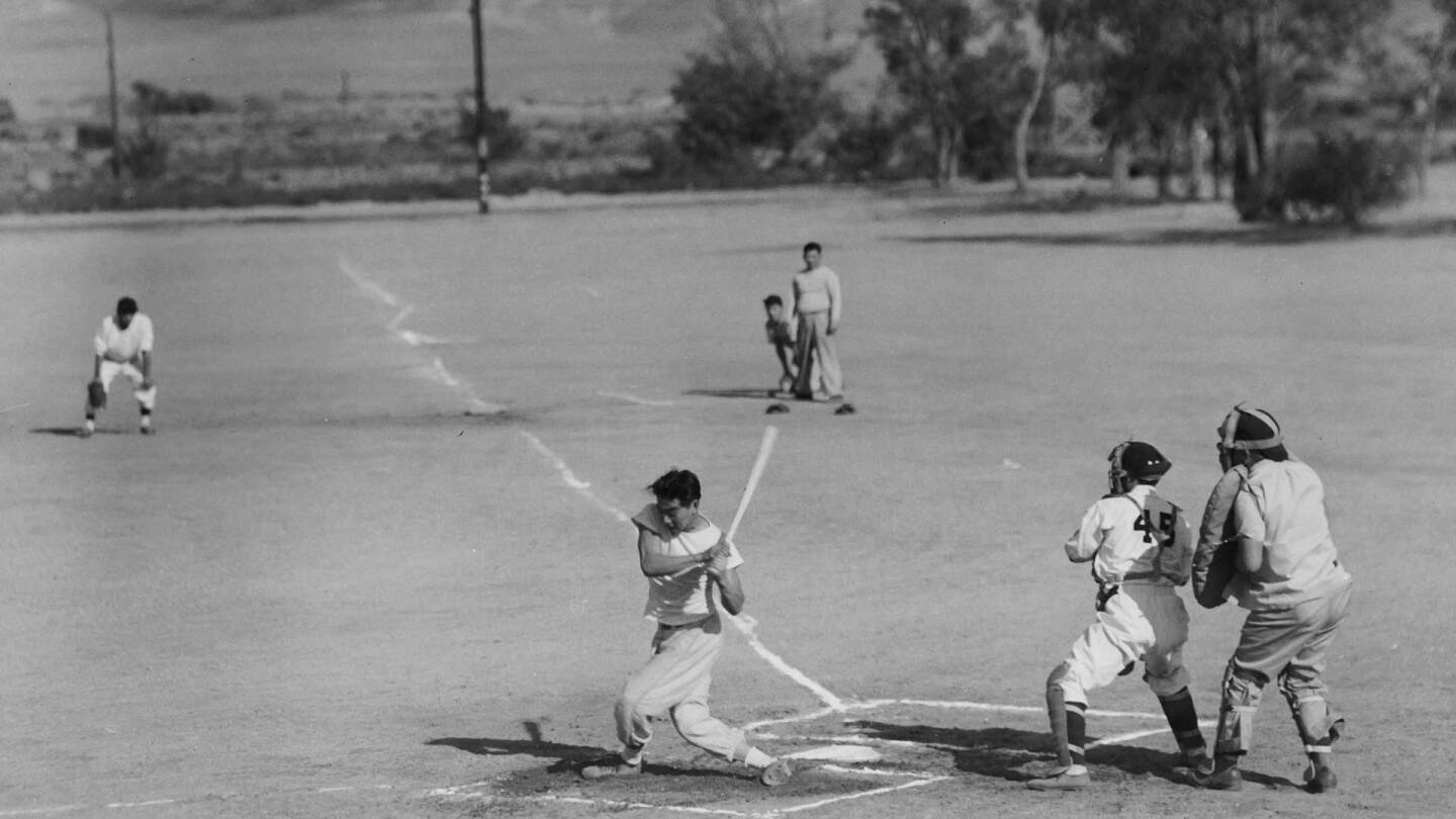 Man playing baseball | Courtesy of Toyo Miyatake Studio