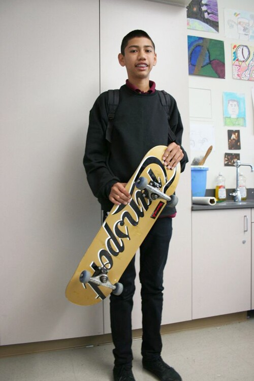 A young man and his skateboard