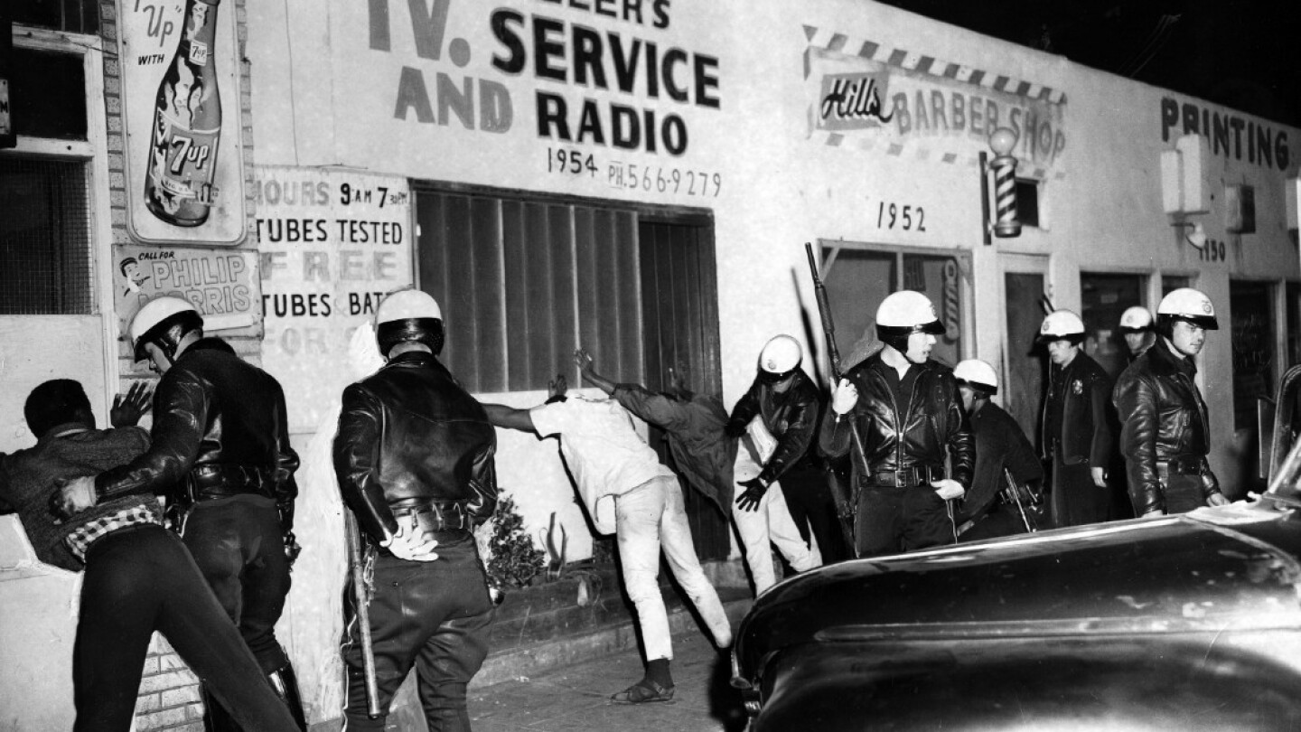 Search for weapons, Watts Riots, 1965   Courtesy the Herald-Examiner Collection/Los Angeles Public Library