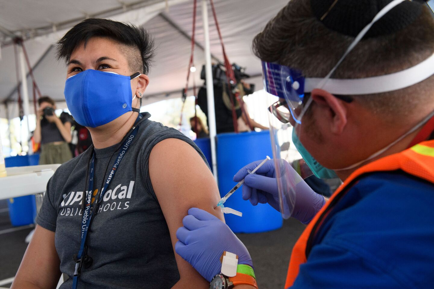 An education worker receives a vaccination at a mass vaccination site in a parking lot at Hollywood Park adjacent to SoFi stadium during the Covid-19 pandemic on March 1, 2021 in Inglewood, California.