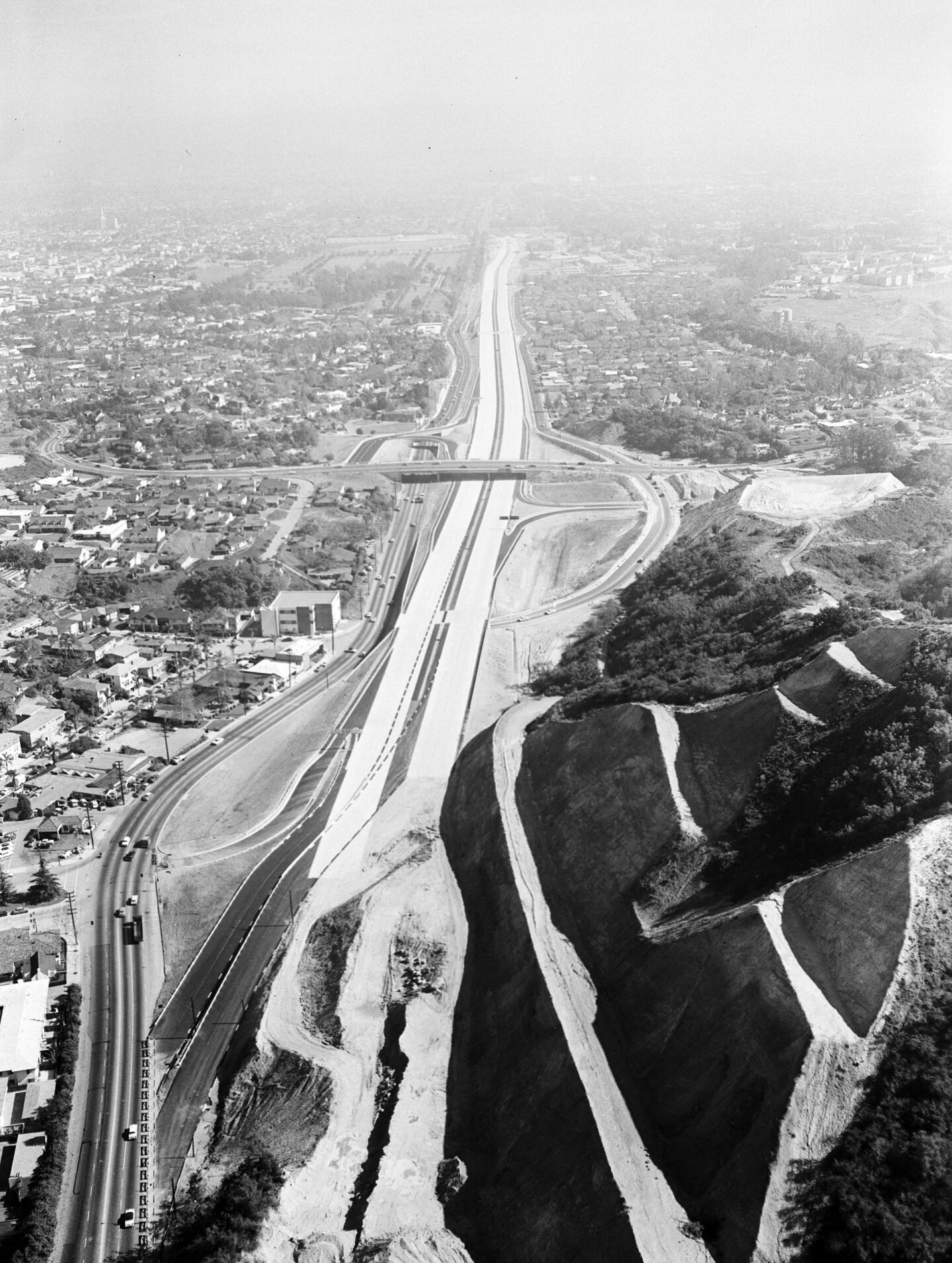 1957 aerial view of the San Diego (I-405) Freeway under construction through Sepulveda Canyon