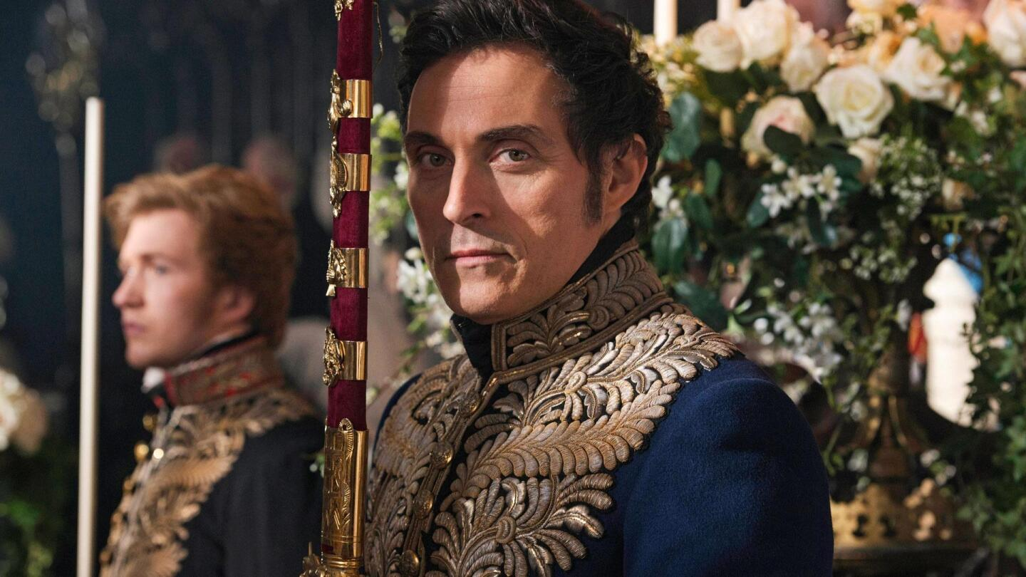 "Lord Melbourne (Rufus Sewell) holds his sword upright and looks straight into the camera. | ""Victoria on Masterpiece: An Ordinary Woman"""